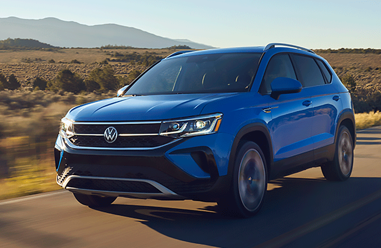 The front view of a blue 2022 Volkswagen Taos.