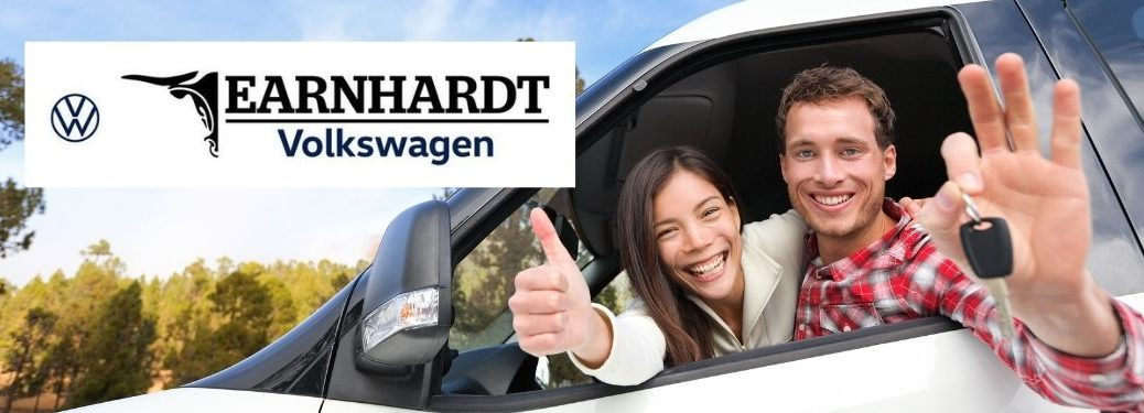 Happy Couple in a Car with Keys and an Earnhardt VW Logo