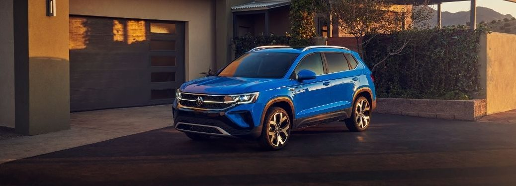 Blue 2022 Volkswagen Taos Front Exterior in a Driveway