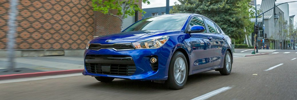 2018 Kia Rio Blue in downtown city streets driving