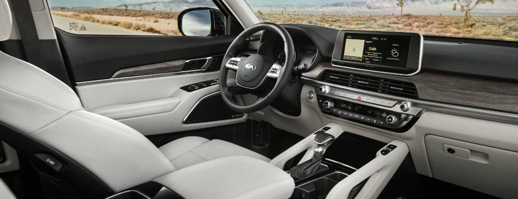 2020 Kia Telluride SUV interior shot of front seating upholstery and dashboard layout design