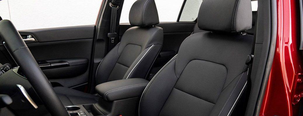2020 Kia Sportage interior shot of front seating black leather upholstery