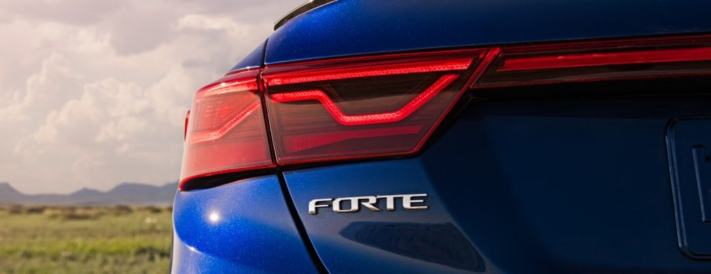 2020 Kia Forte GT with blue paint color exterior rear closeup of model badge name tag under taillights