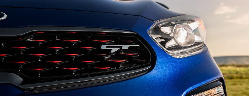 2020 Kia Forte GT exterior closeup shot of headlights, grille, and GT badge