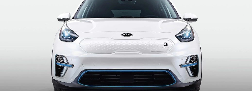 2019 Kia Niro EV exterior front shot with white paint color and empty showcase background