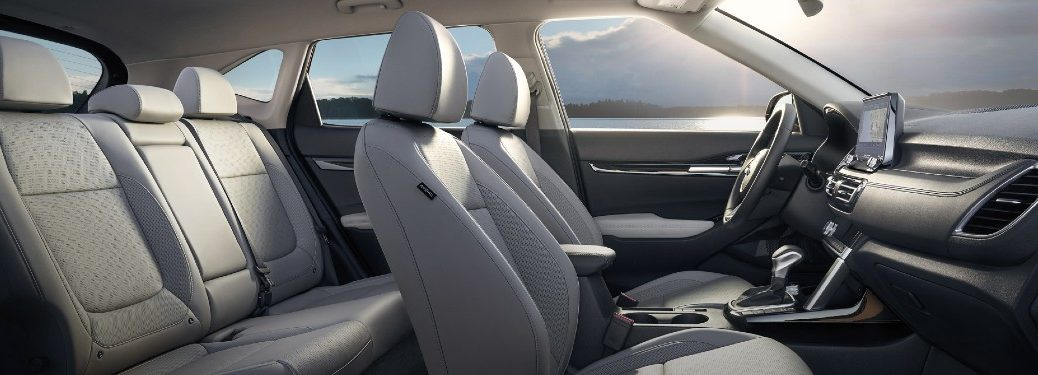 2021 Kia Seltos interior side shot of seating row in white upholstery option