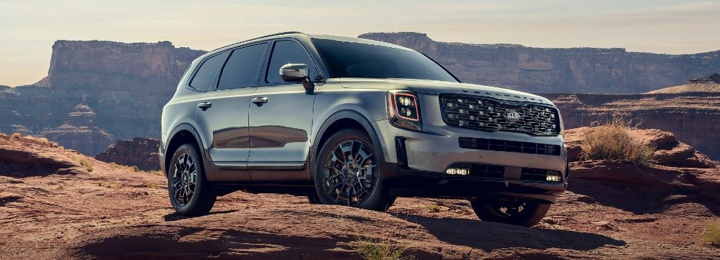 2021 Kia Telluride model exterior shot with gray silver paint color parked on a rocky cliff