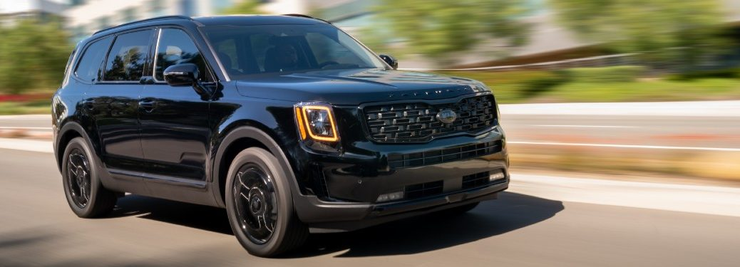 2021 Kia Telluride Nightfall Edition exterior shot as it drives through a city with a blurred background