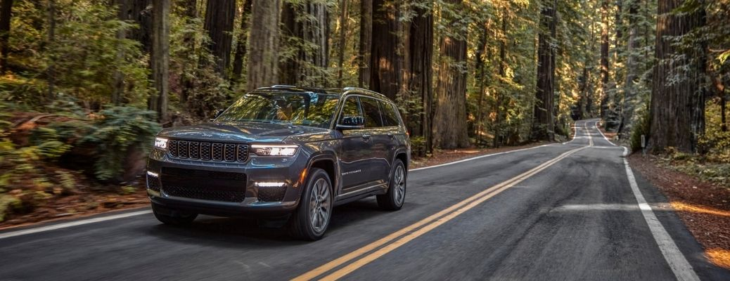 2021 Jeep Grand Cherokee L on a forest highway