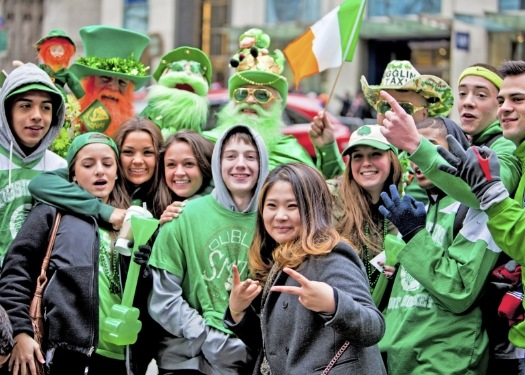 group of people in green celebrating st pats
