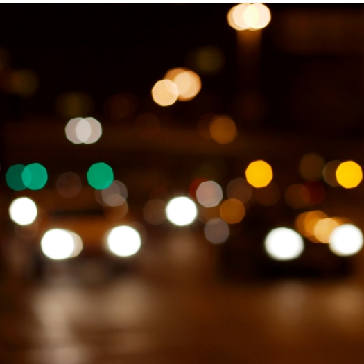 blurred picture of car and traffic lights