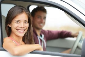 couple smiling in front seat