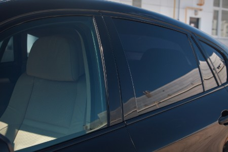 Driver angle of a non-tinted window in front and a tinted window in back