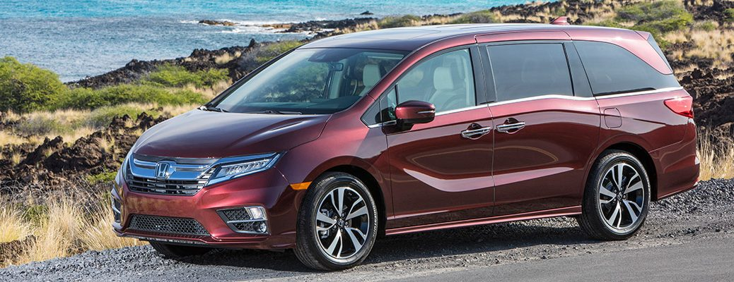 side view of a red Honda Odyssey