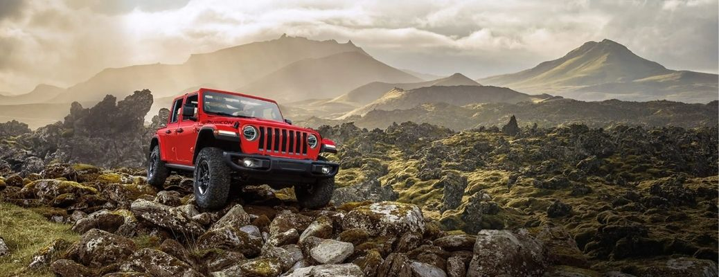 2021 Jeep wrangler travelling through rugged stone-filled terrain