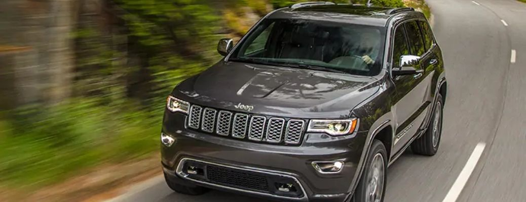 The 2021 Jeep Grand Cherokee racing through the road