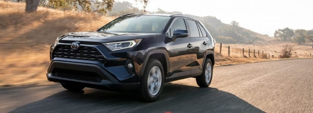 Blue 2021 Toyota RAV4 on a Country Road