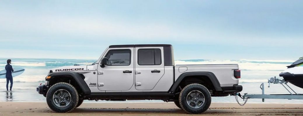 2021 Jeep Gladiator towing a boat