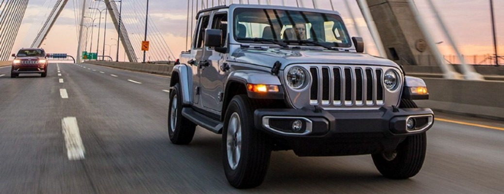 2021 Jeep Wrangler models on a road