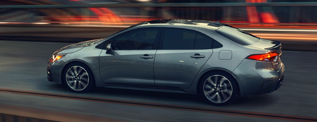 2021 Toyota Corolla grey exterior driver side driving at night