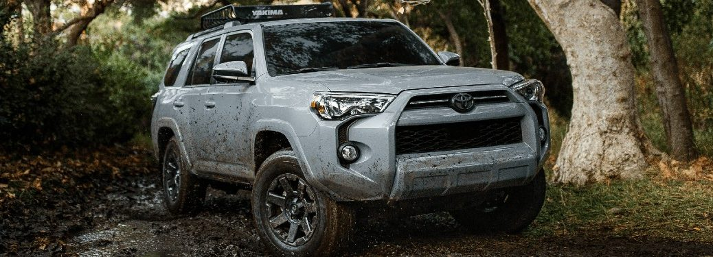 2021 Toyota 4Runner light blue exterior front fascia driving on muddy road
