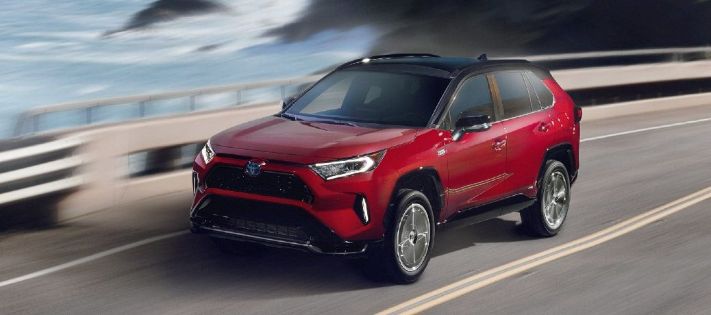 Front driver angle of a red 2021 Toyota RAV4 Prime