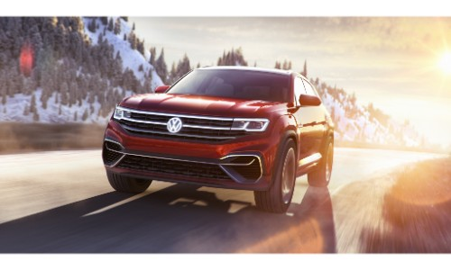 Volkswagen Atlas Cross Sport Concept SUV new york international auto show exterior front shot driving on a snowy tundra road at sunrise