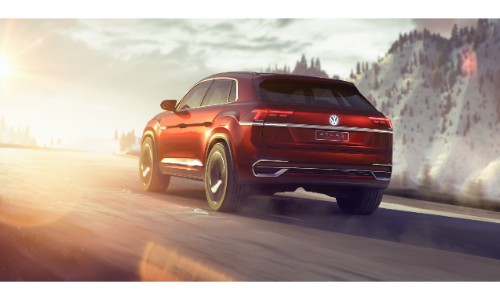 Volkswagen Atlas Cross Sport Concept SUV new york international auto show exterior back shot driving on snow and into the glare from the sun