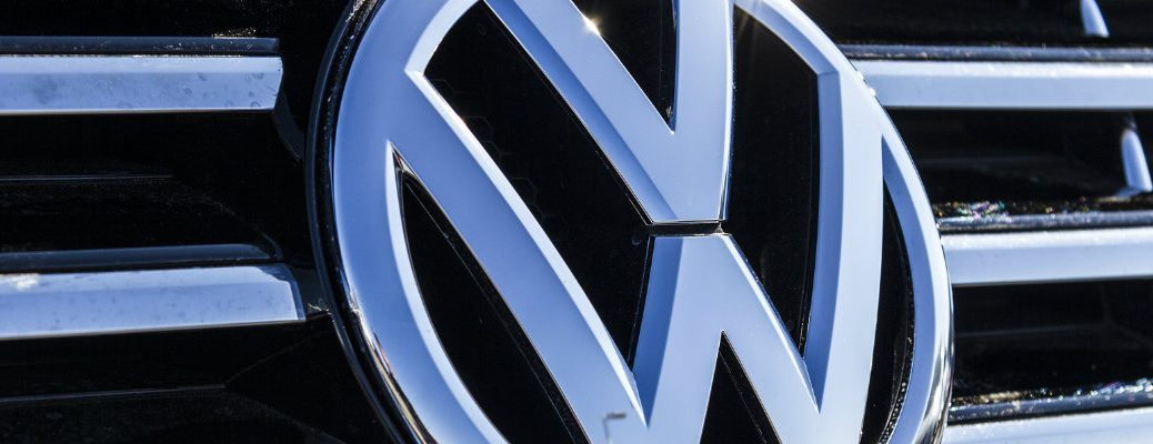 close up of Volkswagen logo grille badge brand on the front of a VW vehicle model
