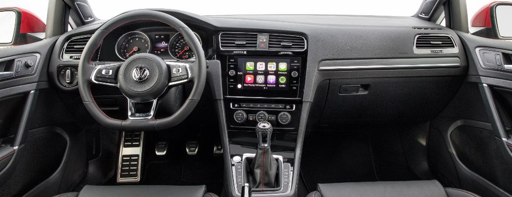 2018 Volkswagen Golf GTI interior shot of front seating, steering wheel, transmission, and dashboard infotainment