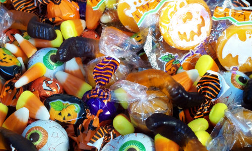 a bunch of assorted, colorful, and sweet Halloween candy