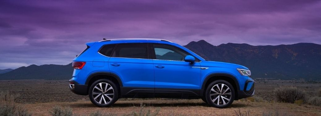 Volkswagen Taos parked outside side view
