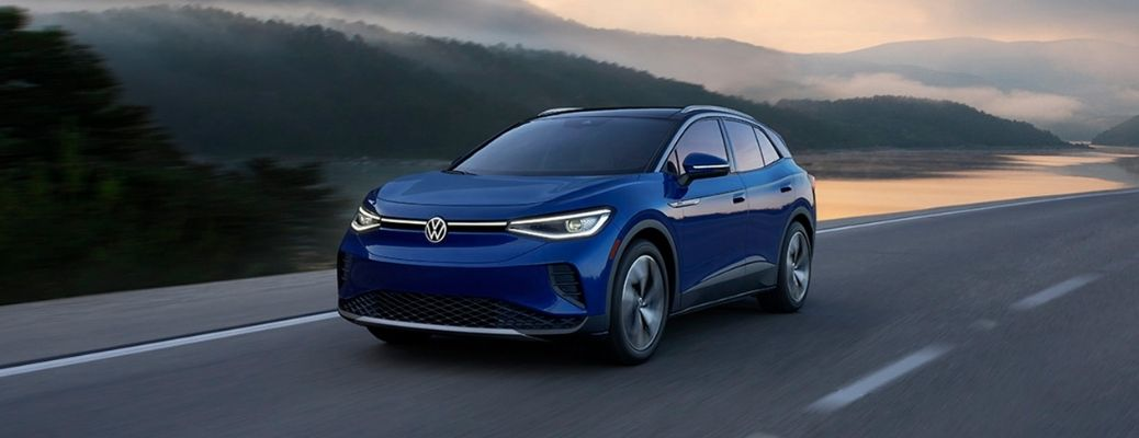 2021 Volkswagen travelling in a road surrounded by mountains