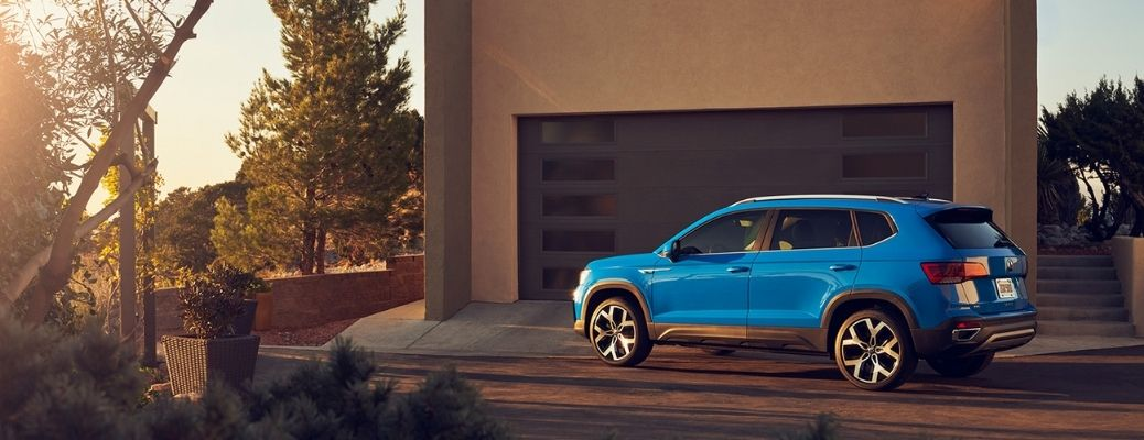 2022 Volkswagen Taos parked in front of a garage