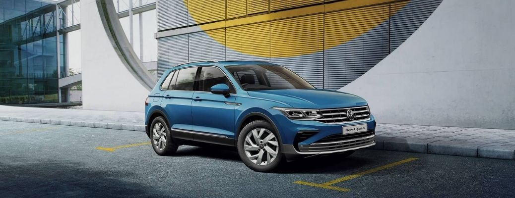 Side-view of the 2021 Volkswagen Tiguan parked in front of the building