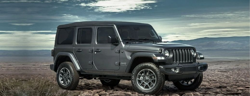 2021 Jeep Wrangler standing in rugged land under blue sky