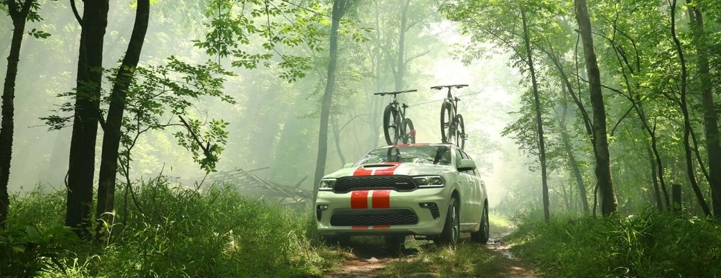 2021 Dodge Durango parked in a forest carrying bicycle