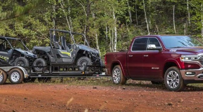 2021 Ram 1500 exterior front fascia passenger side towing 4 wheeler on dirt road