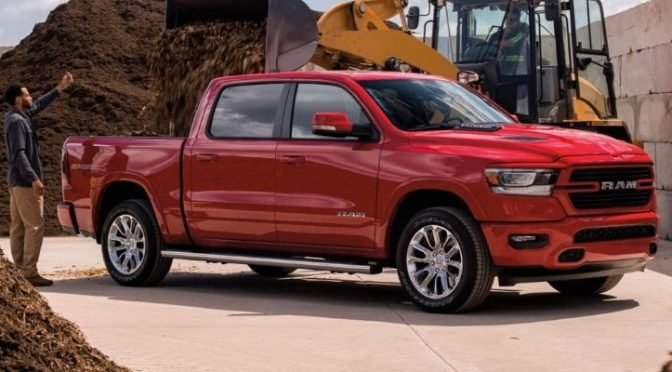 2021 Ram 1500 exterior front fascia passenger side with man standing next to it