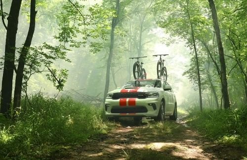 2021 Dodge Durango Driving Through a Forest Front View