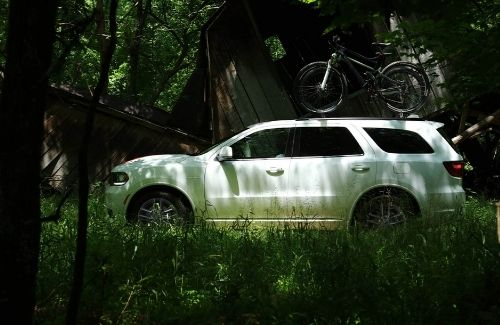 2021 Dodge Durango Driving Through a Forest Left Side View