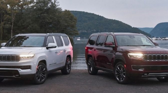 2022 Jeep Wagoneer and Grand Wagoneer standing next to each other in opposite directions