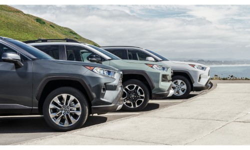2019 Toyota RAV4 gray, mint, and white models exterior shot closeup line up of front tires and noses