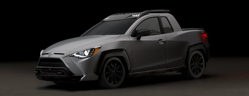 2020 Toyota Yaris Adventure exterior shot with gray paint color set in a dark showroom