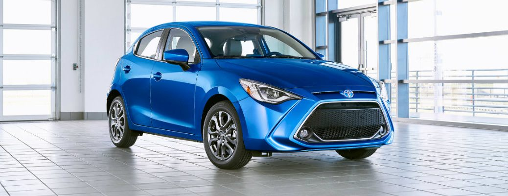2020 Toyota Yaris Hatchback exterior shot with blue paint color parked in a clean white workshop garage