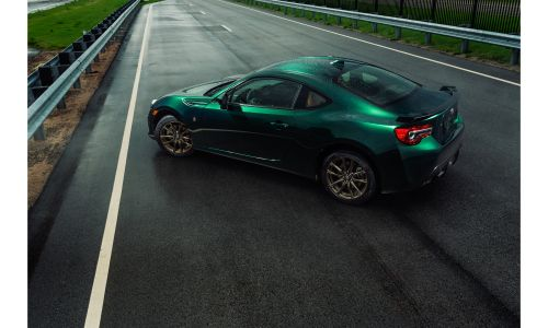 2020 Toyota 86 Hakone Edition exterior overhead shot with exclusive green paint color parked on a race track wet with rain