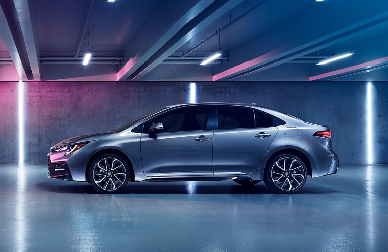 Profile view of silver 2020 Toyota Corolla in parking garage
