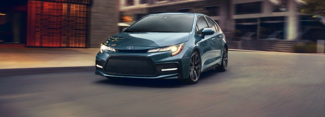 2020 Toyota Corolla driving around street corner
