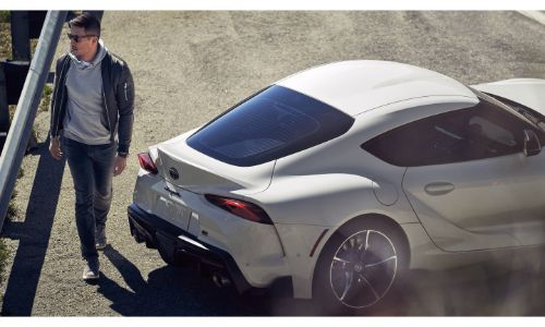 2020 Toyota GR Supra 3.0 Premium exterior rear overhead shot with white paint color as its driver walks by