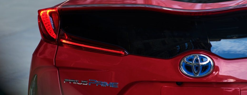 2020 Toyota Prius Prime exterior rear closeup of back end with Toyota badge, Prius Prime model badging, and taillight and trunk lip design